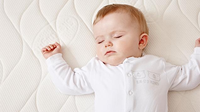 Baby sleeping on safe nights mattress